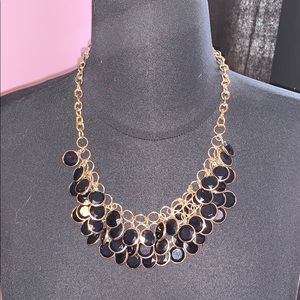 Black statement necklace.